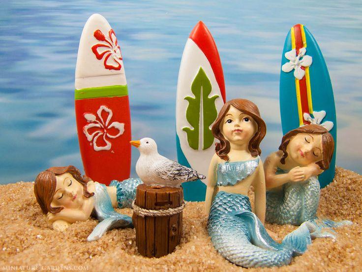 Mini mermaid figurines, tiny surfboards and a seagull in the fairy garden beach.