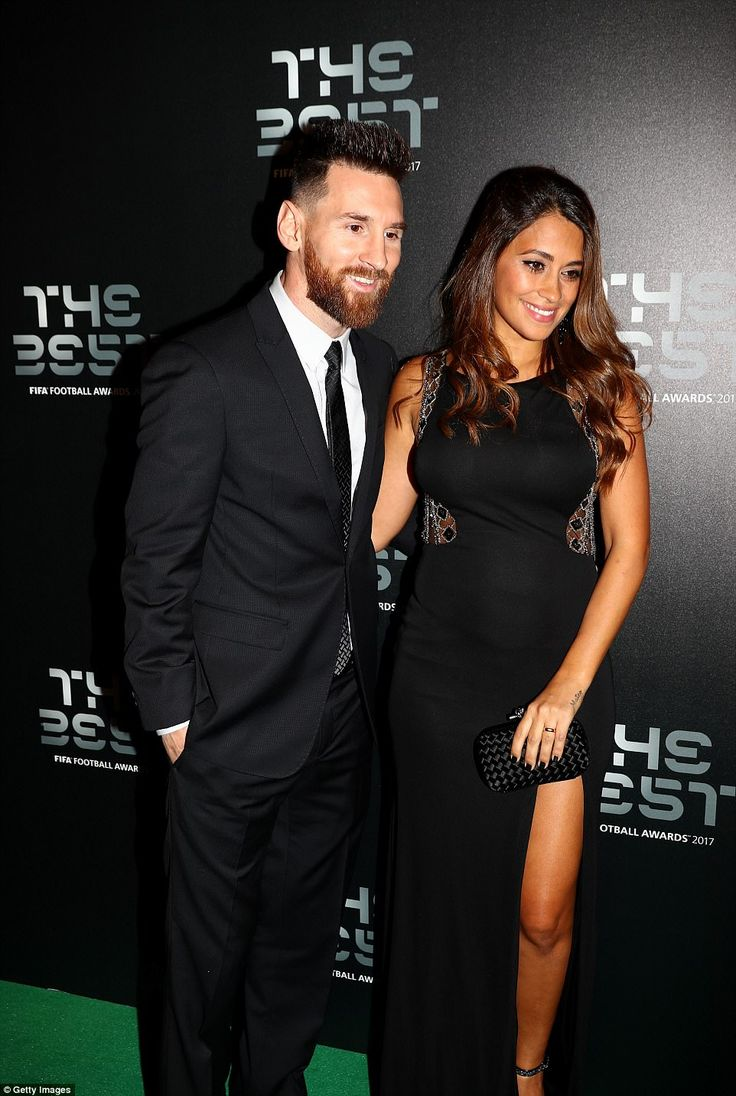 Messi poses for a photograph with wife Antonella Roccuzzo on arrival at the star-studded gala on Monday evening