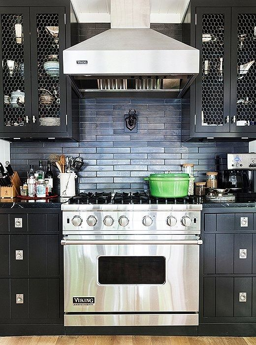 Black cabinets featuring nautical hardware and chicken-wire cabinet fronts are both elegant and totally fitting for Thom Filicia's casually-cool lakeside retreat.