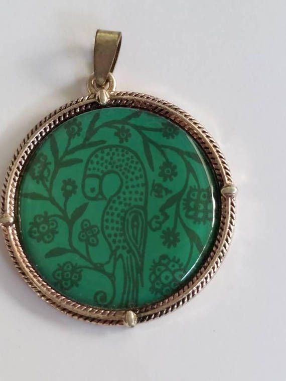 This round pendant has a Partridge bird sitting among many leaves and branches.. just a nice image on a pretty blue green color background. 😊 This pendant will look fabulous in any jewelry project you use it in.    Like all my items, this pendant will arrive in a lovely organza bag. You can use it to give the pendant as a gift or to just store jewelry. There are many possibilities. :o)    All my listings have a 100% satisfaction guarantee. If you are not completely happy with the item, you…