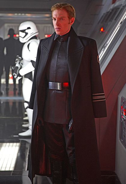 """""""I decided that I would make a definite delineation between the warring armies,"""" he says. So in contrast to the Resistance, the First Order members predominantly appear in black, teal blue, and steel gray, with the Stormtroopers again in white. Their costumes also feature hard lines, like in the uniform worn by General Hux."""