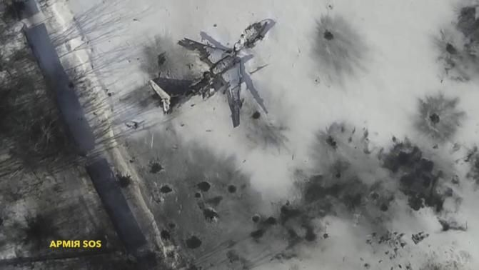 An aerial footage shot by a drone shows an outline of an airplane in the snow at the Sergey Prokofiev International Airport damaged by shelling during fighting between pro-Russian separatists and Ukrainian government forces, in Donetsk, eastern Ukraine, seen in this still image taken from a January 15, 2015 handout video by Army. REUTERS-Army.SOS-Handout via Reuters