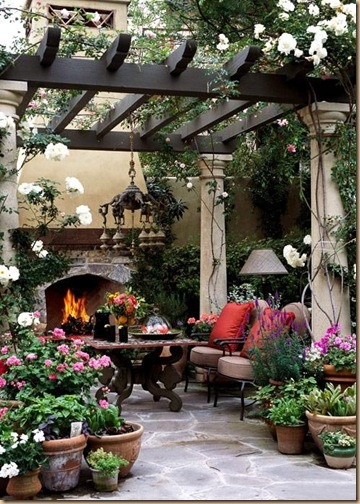 Fireplace + pergola + comfy seating and landscaping. I'd be out here every day!