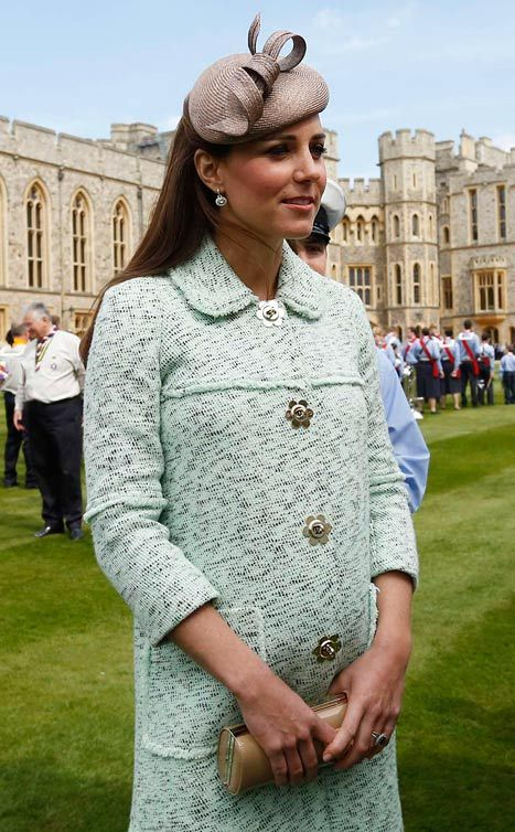 Kate Middleton shows off her growing baby bump while attending the National Review of Queens Scouts on April 21, 2013.
