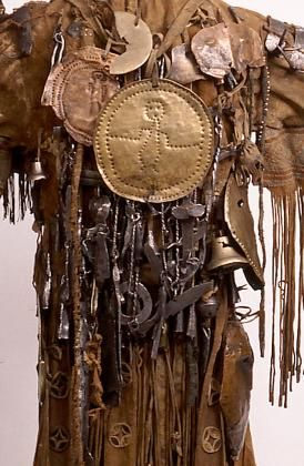 shaman's costume, which is in very good condition, is one of the oldest worldwide. The costume includes a coat, two aprons, boots, different masks, a cap, and many accessories, so that, in fact, it represents a whole shaman's ensemble. Something like 70 metal objects have been affixed to the body of the coat while along each upper arm and on the shoulders are a row of antler-like iron ornaments