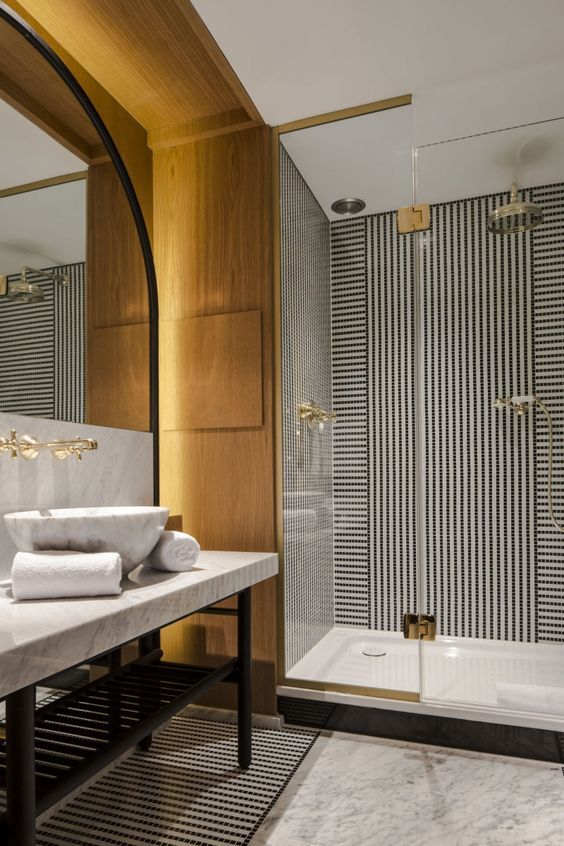 Creating a high-end bathroom right in your own home isn't as daunting as it seems. Believe it or not, adding a few key elements and beyond-basic designs can turn an...
