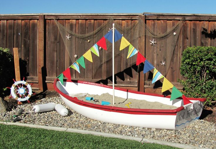 Turned an old fiberglass sailing boat into a huge sandbox for the kiddos.