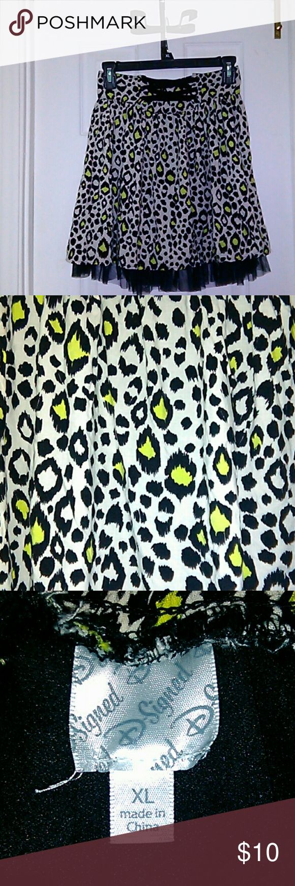 Fun & Frilly Neon Cheetah Print Skirt Girls just wanna have fun! Neon Cheetah Print  Skirt; black and white with hints of neon yellow. Black organza finishes off the hem. Gently used, gentle cycle and line dried. Go have some fun now! Disney Bottoms Skirts