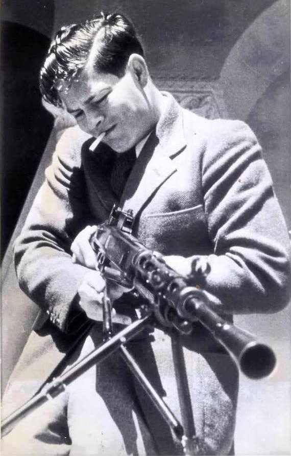 King Michael I of Romania at the age of 21, testing a Russian machine-gun (probably the Degtyaryov/DP-28 machine-gun) in Sevastopol (1942).