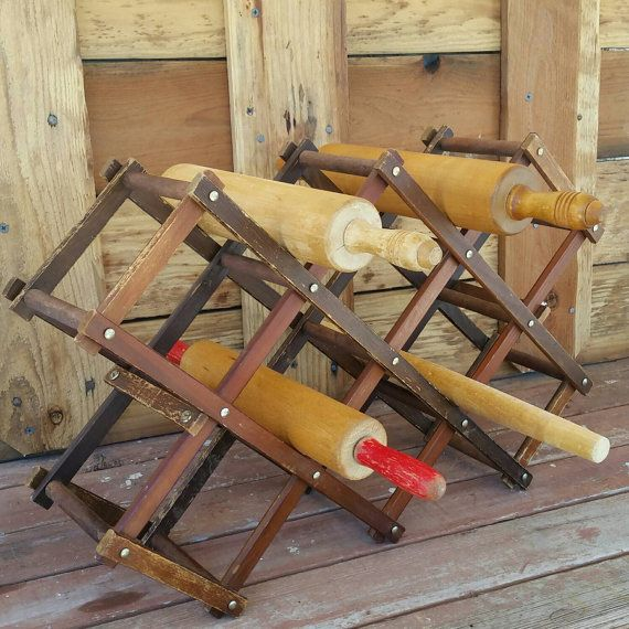 Vintage wine rack used for displaying rolling pins.