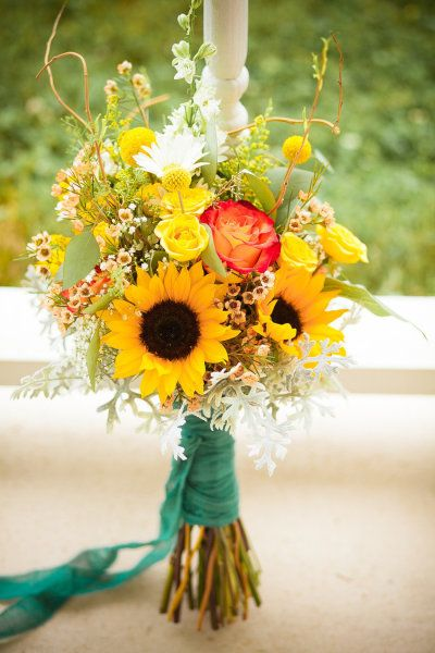 Sunflower bridal bouquet Photography by Raebeam