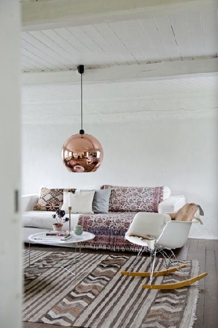 Brilliant combo of neutrals and traditional patterns, with a really modern (GORGEOUS BRONZE) light and rocker. Small simple table so it doesn't dominate.