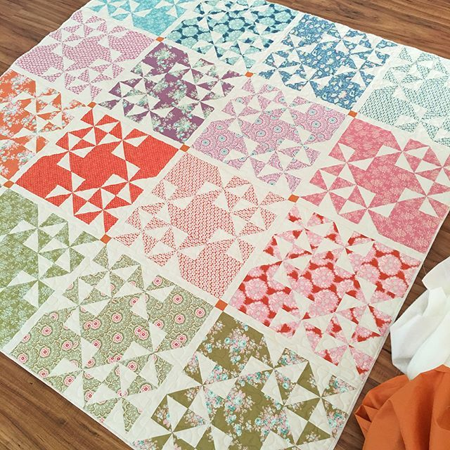 Here's a couple more images of my #harvestmarketquilt I found on my camera roll, pre binding.  You might be able to see that for full size quilts I like to leave approximately 1/4 of batting and backing extended beyond the quilt top...