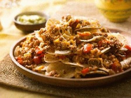 Double Cheese Nachos Supremos via Ontario Turkey.    Swap out high fat products (cheese, sour cream) for lower-fat versions.  Use up stale tortillas - using a pizza cutter, cut in to wedges.  Toast in oven.