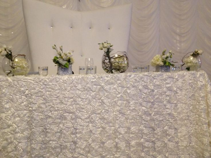 White peonies bouquets for headtable with branches in vase