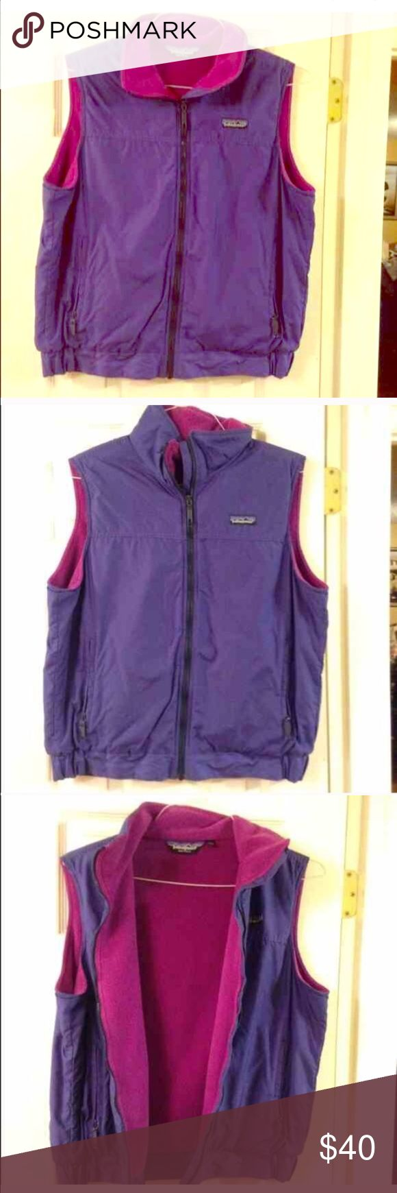 Patagonia Zip Up Vest Pink/purple Girls Size 12 Patagonia vest. This fits a women's small/medium. Gently used. Patagonia Jackets & Coats Vests