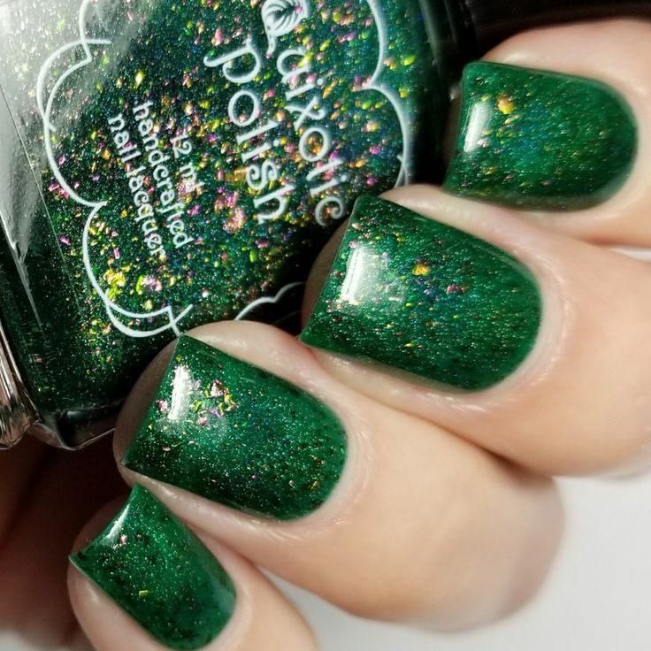Tsavorite is an Emerald jelly full of UCC flakies and holo sparkles! Opaque in 2-3 coats Please allow 3-5 days for processing Ingredients: Ethyl Acetate, Butyl Acetate, Nitrocellulose, Isopropyl Alcohol, N-Butyl Alcohol, Acrylates Copolymer, +/- Polyethylene Terephthalate, Aluminum, Mica, Titanium Dioxide, Iron Oxide, Ferric Ferrocyanide, Red 28, Red 22, Orange 5, Yellow 11, Violet 2 ext, Red 6, Red 7, Yellow 6, Yellow 5, Blue 1, Ultramarines, Bismuth OxychlorideSwatches c...