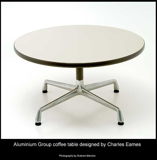 Charles Eames Aluminium Group coffee table. Off-white melamine top supported on a single grey painted pedestal and four-star 'universal' aluminium base. 76cm diameter x 41cm high. Mfd by Herman Miller.