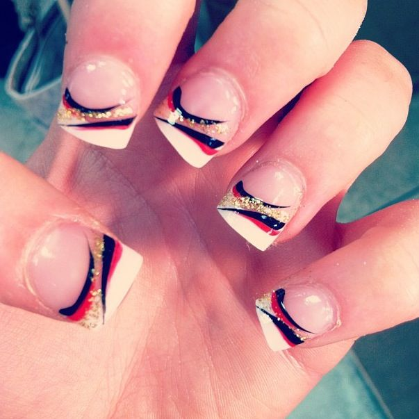 french tip with red black and gold sparkle design nails