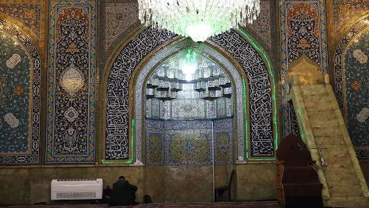 Inside Shah Mosque of Tehran which is overwhelmed by blue tiles with Qur'anic Thuluth inscription and floral as well as foliages. The mosque was built during the reign of Naser al-Din of Qajar period (1810-1825 AD).  Tehran, April 2017.