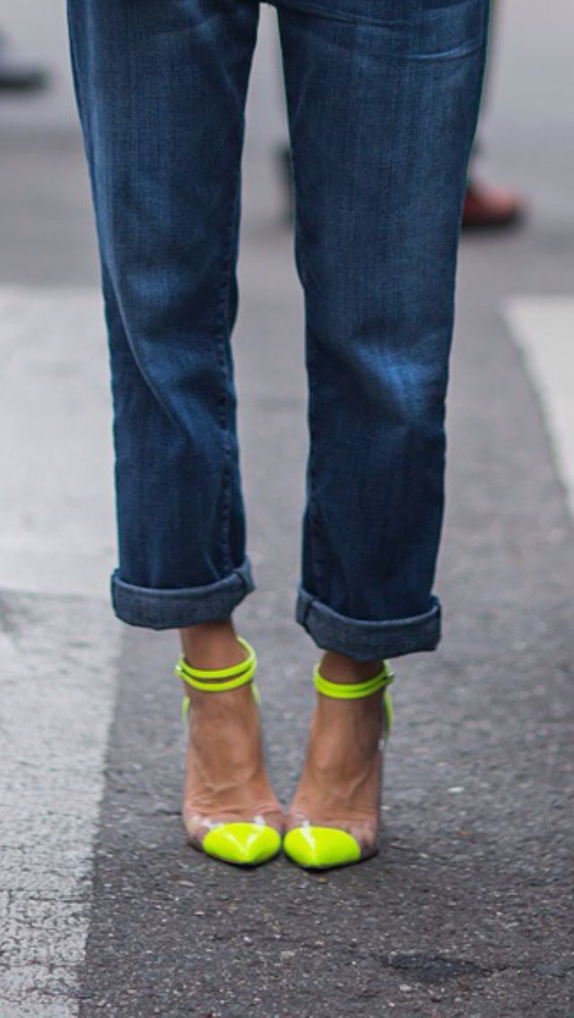 boyfriend jeans and neon pumps.