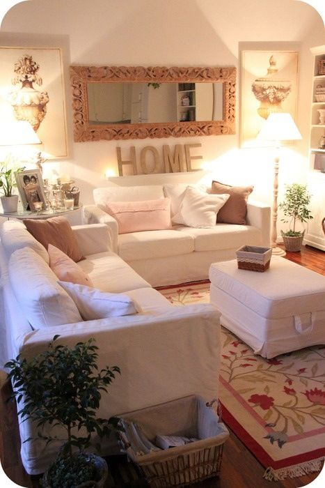 Shabby Chic | Living Room | White Furniture | Area Rug | Wall Decor | Bright Lights | Pink Accents | Natural Foliage | Oversized Mirror