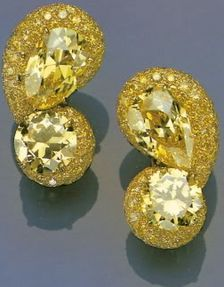 Yellow Diamonds -- The Duchess of Windsor collection. The pear-shaped yellow diamonds top with circular diamonds, were re-mounted as earclips by Cartier in 1968. They could be attached to each other or worn separately.