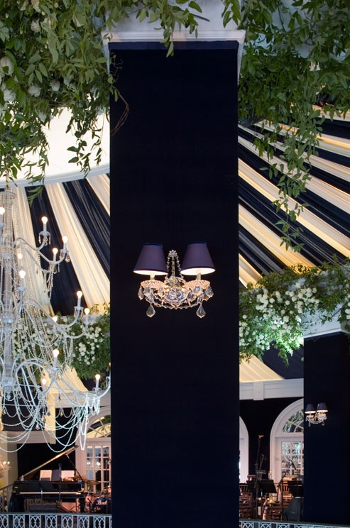 Every detail was personalized, from the navy and white draped ceiling to the crystal sconces on the tent's columns.