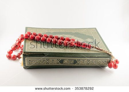 Islamic Book Holy Quran and beads on withe background - stock photo