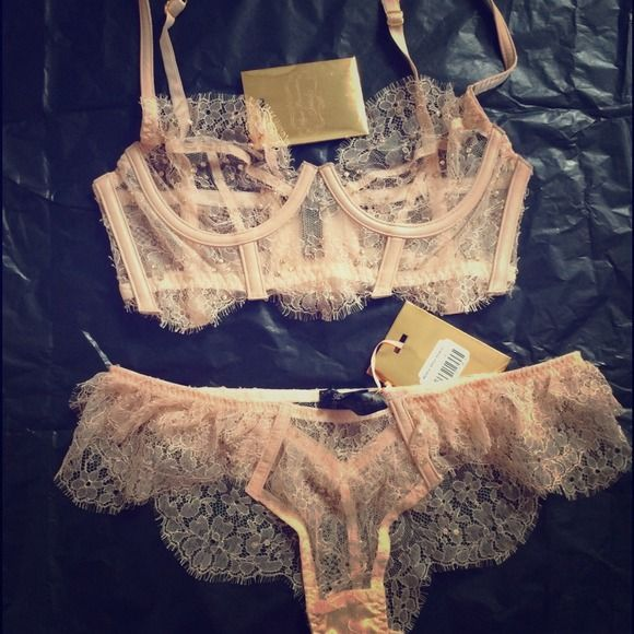 Stunning Swarovski handmade lingerie set !! 2 PC sultry lace bra and panty set. Embroider nude pink lace with Swarovski crystals on both , woven pink leather seams. Beautiful set ! One size too big for me never worn! Agent Provocateur Intimates & Sleepwear