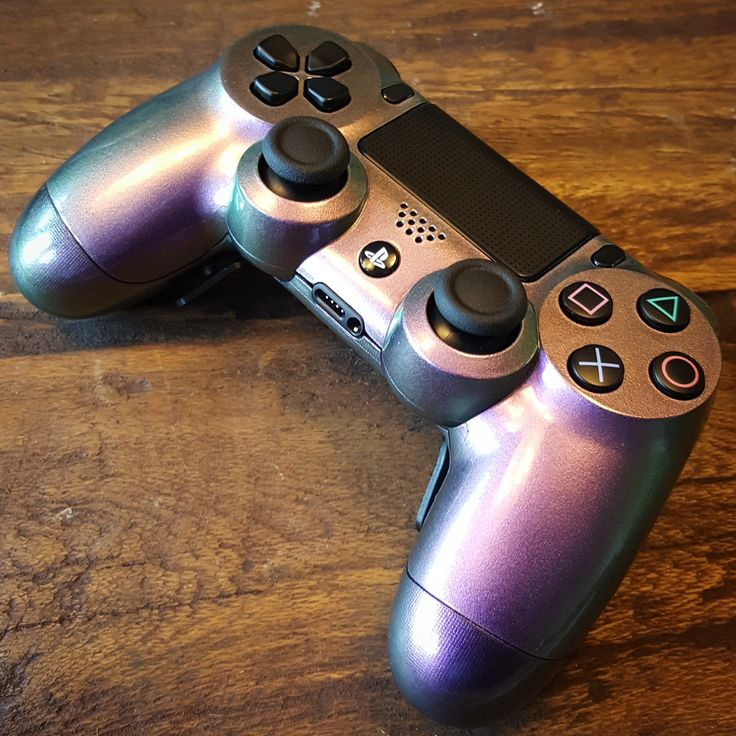 PS4 controller with chameleon paint and Shock paddles.