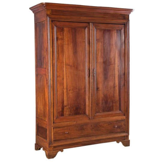 Louis Philippe Period Walnut Armoire <p>A Louis Philippe Armoire made of gorgeous walnut wood purchased in the Provence Region. The Armoire has paneled doors and rests on bracket feet. The inside features 3 shelves, the middle shelf has 3 drawers. A classy piece!</p>