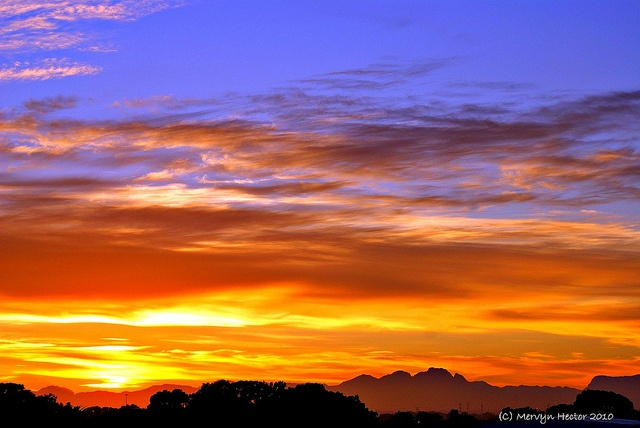 Sunrise over the Cape Flats by Mervyn Hector