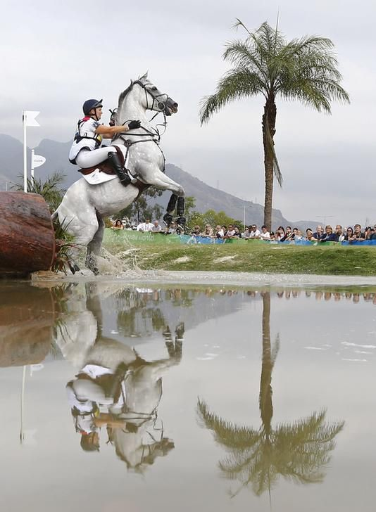 OLYMPICS-RIO-EQUESTRIAN-EVENTINGIND Gemma Tattersall of United Kingdom riding Quicklook V attempts the cross of a water obstacle in the individual cross country. REUTERS/Tony Gentile
