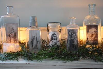 pretty bottle display using vintage prayer cards