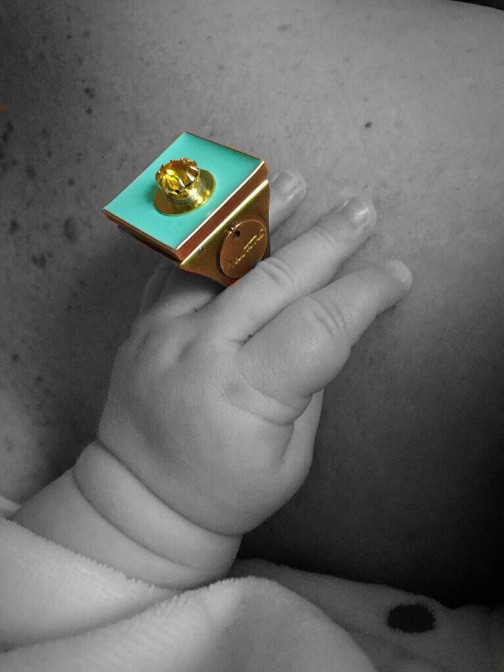 Natanè Planet ring on a baby's hand. #ring #anello #colors #turchese #woman #turquoise #hand #baby #children #fashion #style #outfit #swarovski #jewel #bijoux #door #porta #gate #girl #natanè