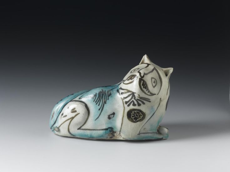 Figure of a cat in earthenware glazed white and green, features outlined in dark brown, used for rubbing the soles of the feet in the hammam or hot bath: Persia, 17th century