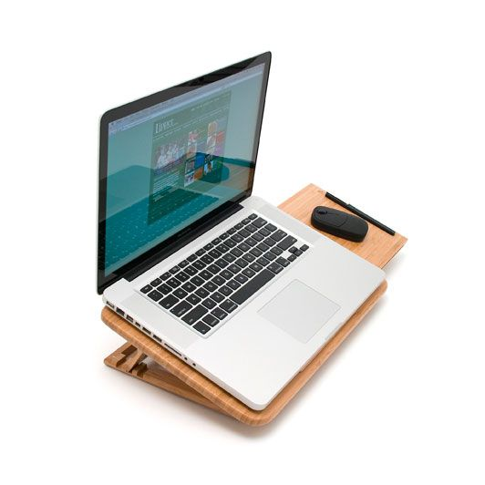 Raw wood and creative spaces fit together in wonderful matrimony. Use the expandable and adjustable Bamboo Laptop Tray as your go-to piece for browsing and working on your laptop. A clean shape and des...  Find the Bamboo Laptop Tray, as seen in the Breaking News Collection at http://dotandbo.com/collections/breaking-news?utm_source=pinterest&utm_medium=organic&db_sku=LPI0003