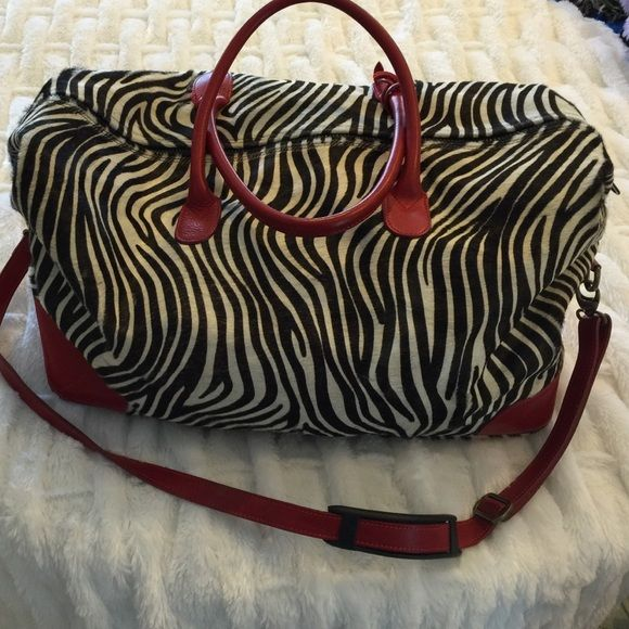 Italian designer zebra animal print tote bag Great weekend bag or carry on. Bought for trips where I would need an expensive bag:) Liked it too much to use, so like new. Hair on hide, very high end Italian designer bag. No brand Bags Travel Bags