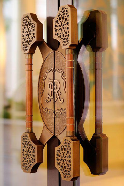 Doors to the lobby at The St. Regis Saadiyat Island Resort, Abu Dhabi, designed by HBA/Hirsch Bedner Associates.