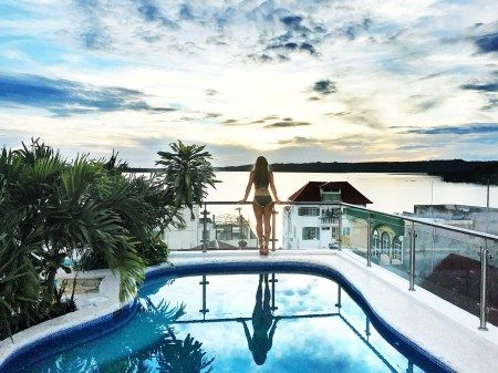 sunset at rooftop pool hotel isla de flores