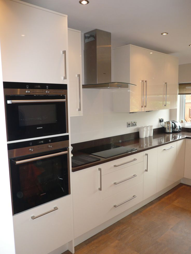 Lovely acrylic doors in cream gloss, Stada Quartz worktops and Siemens Appliances...