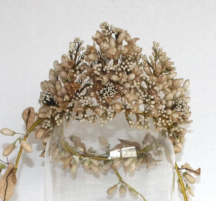 an antique French Bridal Crown from the 1800′s featuring many different shapes and sizes of flowers, all wax.