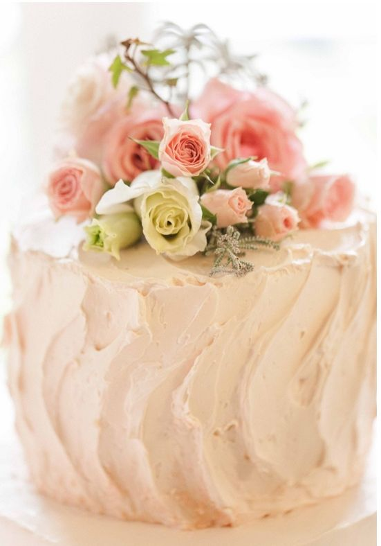 homemade wedding cake with live flower topper