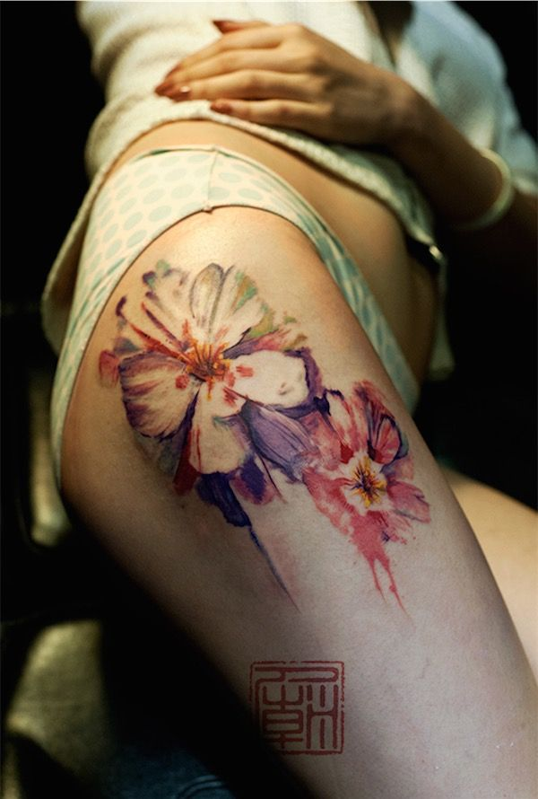 Thigh tattoo - Such pretty colors and style. I commend the artist who did this. It looks so natural. #TattooModels #tattoo
