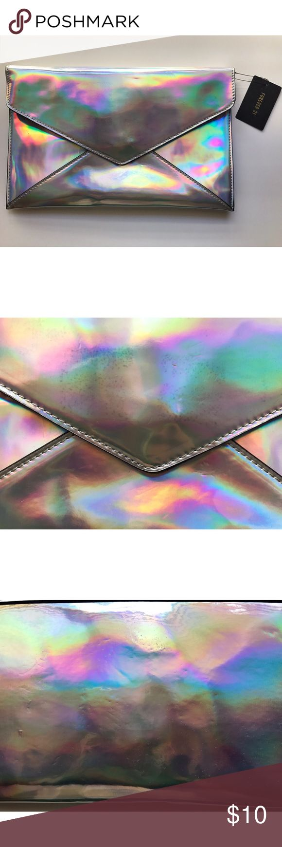 Forever 21 Holographic Clutch Forever 21 Holographic Clutch. NWT, but has small dents in it as shown due to just being in my closet. Forever 21 Bags Clutches & Wristlets