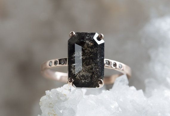 natural black, salt + pepper diamond has gorgeous cut, clarity, + shimmer! this diamond is conflict-free and ethically sourced, weighing over 3 carats! prong-set in handcrafted 14kt recycled rose gold with a smooth, polished finish + our pavé diamond band. the perfect unique engagement ring! -natural, conflict free, black diamond weighs 3.28ctw + measures 12.2 x 8.4mm -14kt recycled rose gold prong setting + band 10 pavé set 1.2mm diamonds -smooth, polished band measures 1.5 x 1mm *ring…