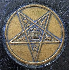 The Eastern Star emblem from an antique embossed leather case.