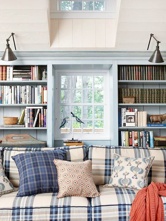 The living room doesn't have to be stuffy and formal.  This one has a cozy, yet traditional feel with a blue and white plaid sofa.  Toss in a few bold pillows and a coral throw for a pop of color.  French blue walls give a nice calming effect.  Built-in bookcases give the room a nice architectural element.