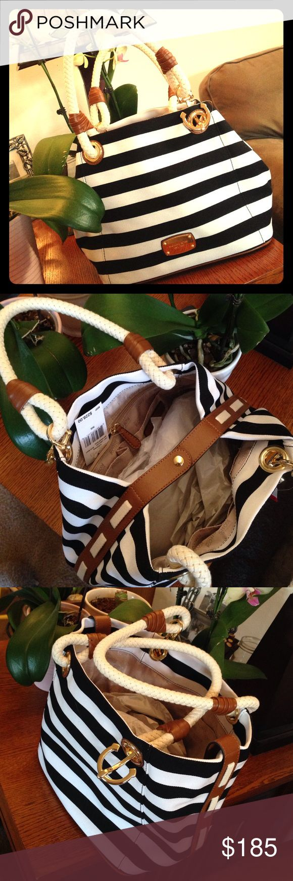 Micheal Kors Canvas Marina grab bag Micheal Kors black and white striped canvas grab bag with brown leather trim. NWT. Beautiful summer purse!! Any questions just ask!!! Michael Kors Bags Shoulder Bags